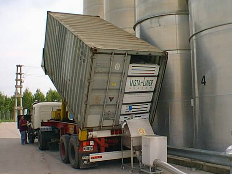 Silo loading from shipping container.